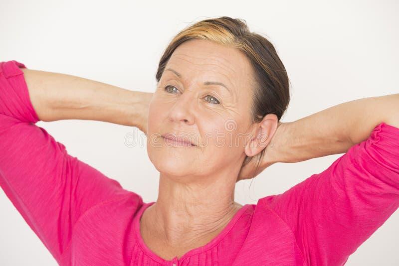 Relaxed senior woman daydreaming stock photos