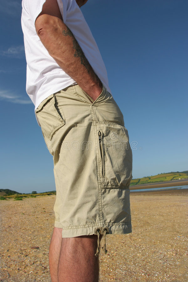 Download Relaxed in Shorts stock image. Image of khaki, tattoo - 1475681