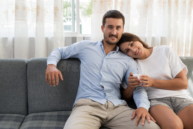 Relaxed smiling couple stock images