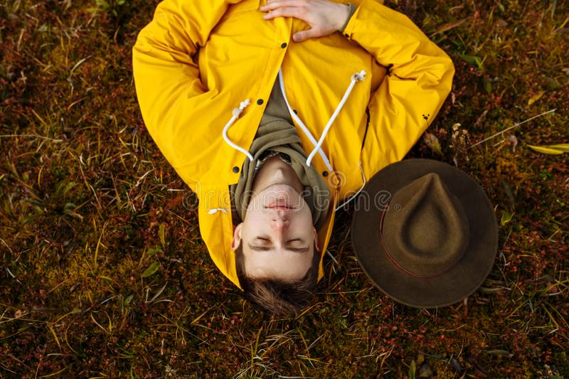 Relaxed tourist sleeping on the ground, tourist enjoying the beauty of nature stock photo