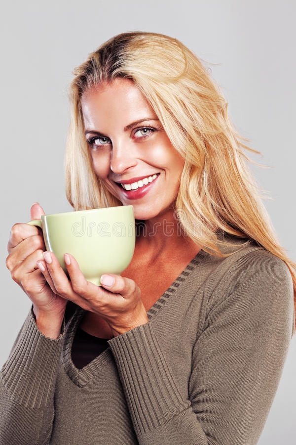 Relaxed woman having a cup of tea stock photo