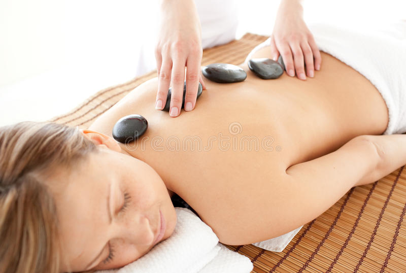 Relaxed woman having a massage stock image