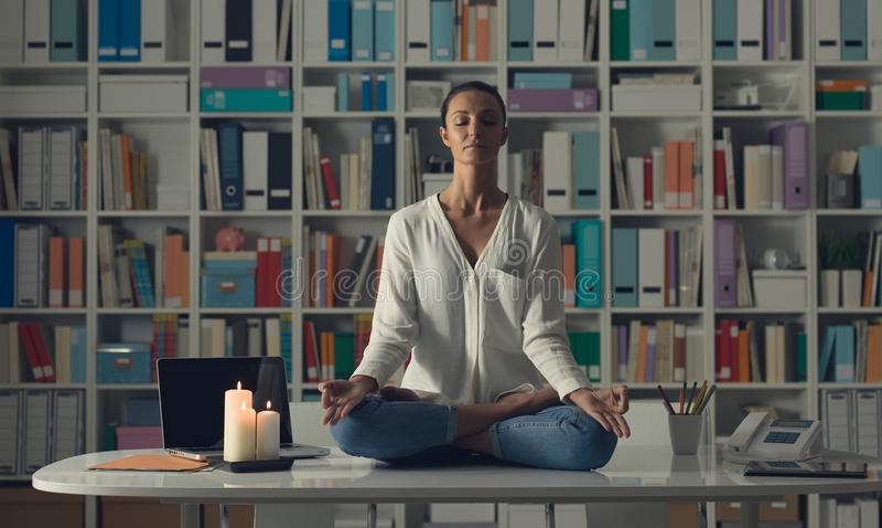 Woman practicing meditation at home royalty free stock photo