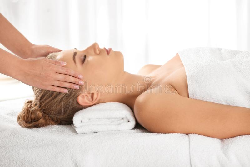 Relaxed woman receiving head massage royalty free stock photo
