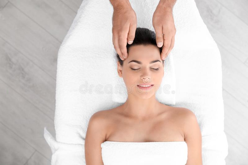 Relaxed woman receiving head massage royalty free stock image