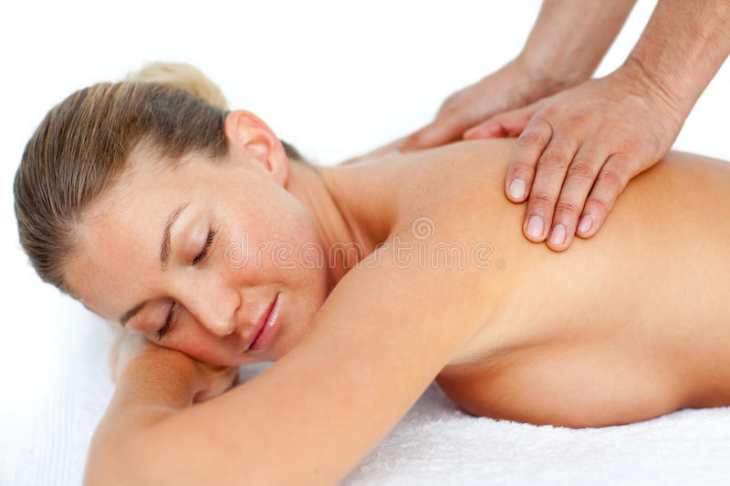 Relaxed Woman Receiving A Massage Royalty Free Stock Image