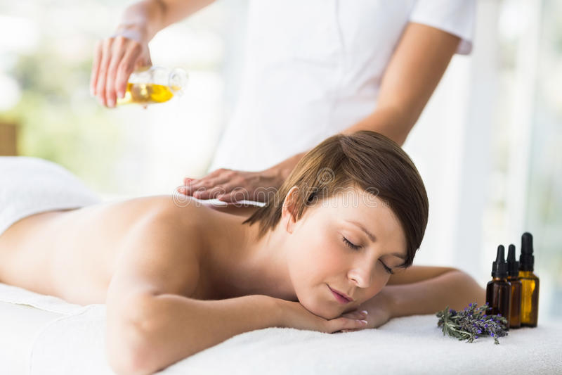 Relaxed woman receiving massage treatment. At spa royalty free stock photo