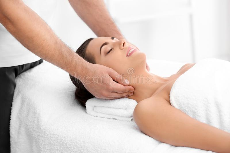 Relaxed woman receiving neck massage royalty free stock images