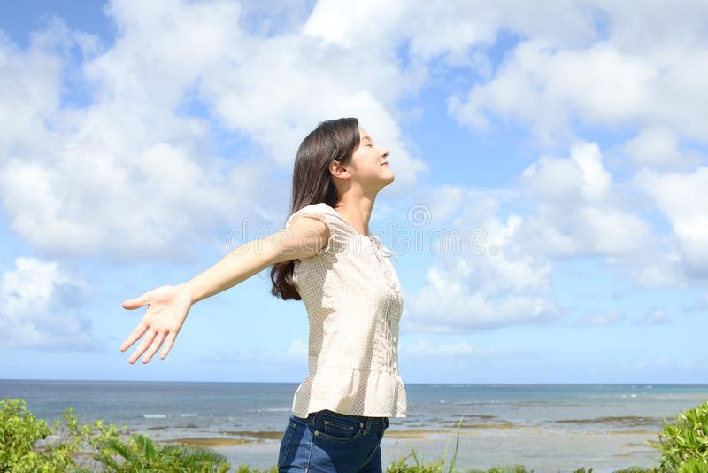 Woman enjoy the sun. royalty free stock photography