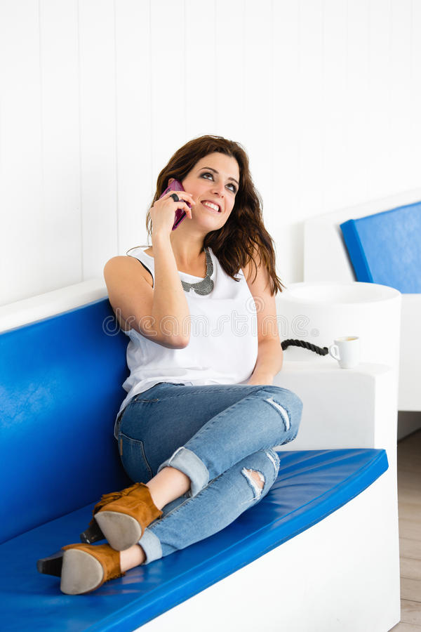 Relaxed woman talking on the phone royalty free stock photos
