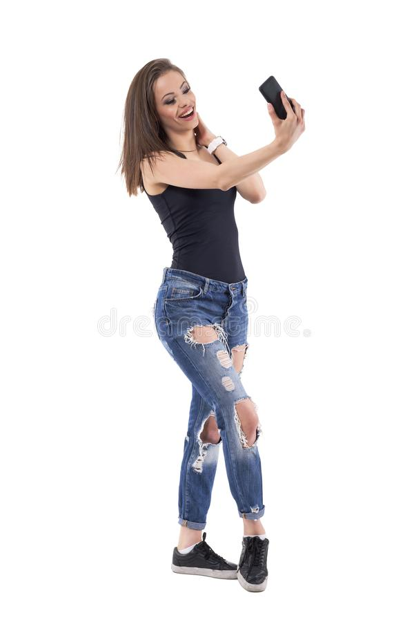 Relaxed young beautiful woman taking selfie and sending photo messages. stock photo