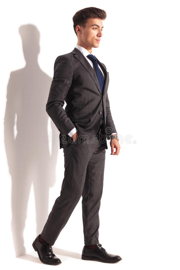 Relaxed young business man walking stock photos