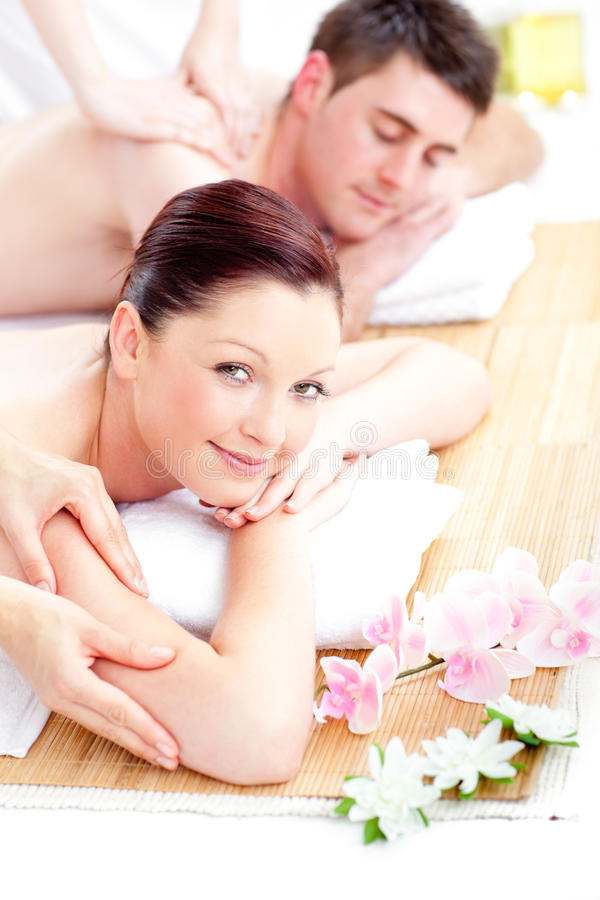 Relaxed young couple receiving a back massage. In a spa center stock photos