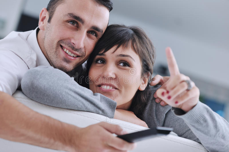Download Relaxed Young  Couple Watching Tv At Home Stock Photo - Image: 21963196