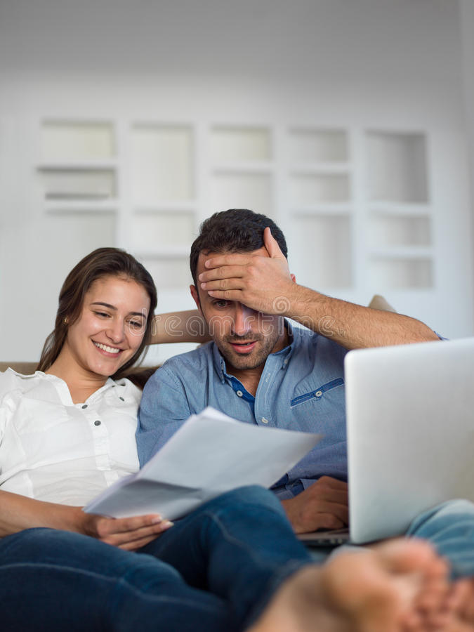 Free Relaxed Young Couple Working On Laptop Computer At Home Royalty Free Stock Photo - 42518925