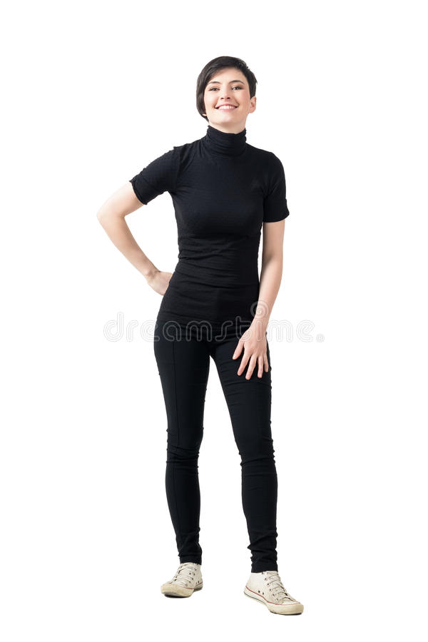 Relaxed young fashionable girl in black turtle neck t-shirt posing and smiling at camera. royalty free stock photography
