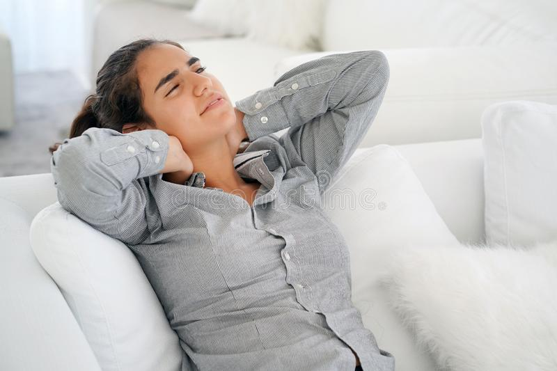 The girl is lying on the couch relaxing royalty free stock photos