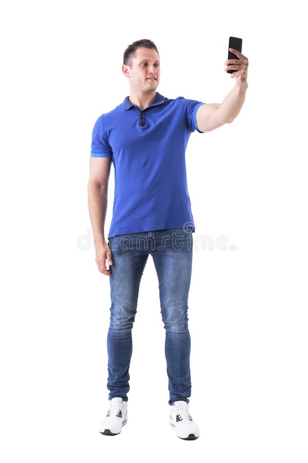 Relaxed young happy man taking selfie photo with smart phone. Full body isolated on white background royalty free stock photography