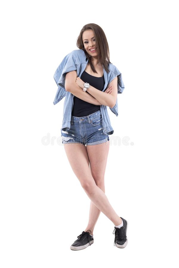 Relaxed young teenage beautiful woman smiling with protruding tongue royalty free stock photo