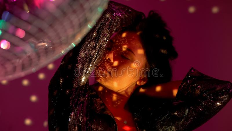 Relaxed young woman dancing at disco party, enjoying club atmosphere, seduction. Stock photo royalty free stock images