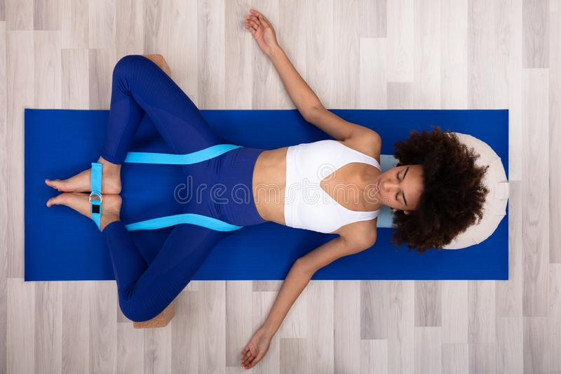 Relaxed Young Woman Doing Exercise royalty free stock photos