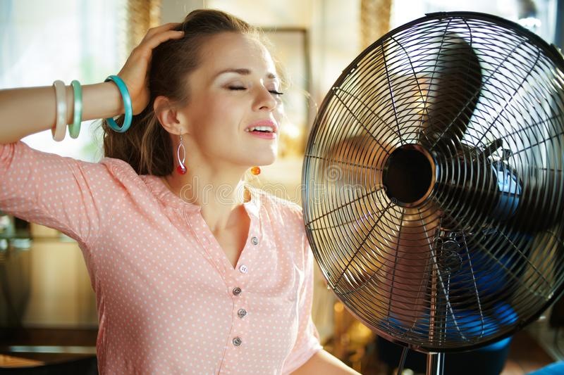 Overheated African Young Woman Feeling Hot Waving Fan At