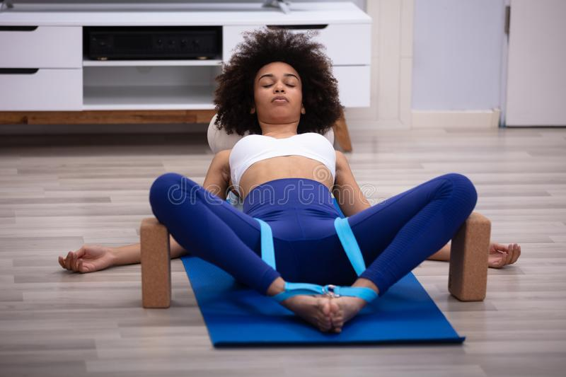 Relaxed Young Woman Doing Exercise stock photography