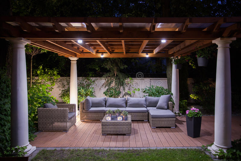 Relaxing area outside of mansion. Photo of relaxing area outside of mansion at night royalty free stock image
