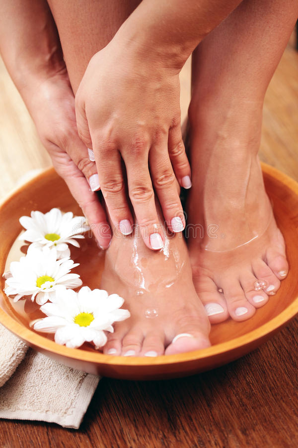 Relaxing bath with flowers stock photography