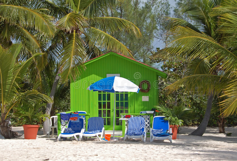 Relaxing beach escape in small green bungalow stock images