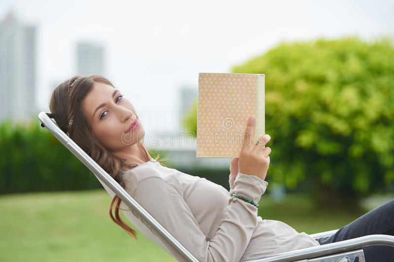 Relaxing with a book royalty free stock images
