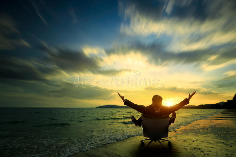 Relaxing. Businessman sitting on beach, Success in business concept stock images