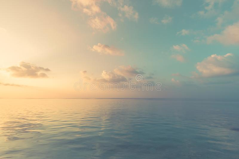Relaxing and calm sea view. Open ocean water and sunset sky. Tranquil nature background. Infinity sea horizon. Tranquil and relaxing and calm nature sea and sky royalty free stock image