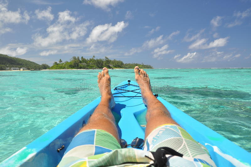 Relaxing in a canoe - Rarotonga, cook Islands royalty free stock photography