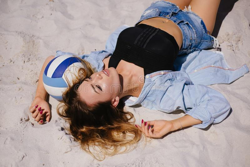 Relaxing in complete solitude. woman lying on sand. Pretty woman relax on summer day. Sensual woman enjoy idyllic stock photo