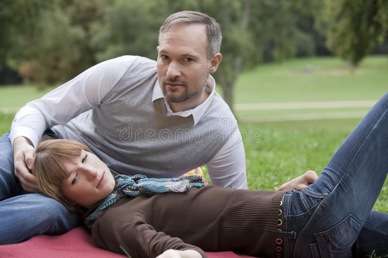 Relaxing couple in park stock images