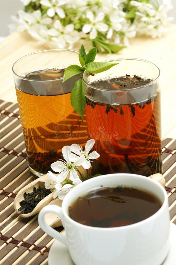 Relaxing cup of fruit tea stock photos