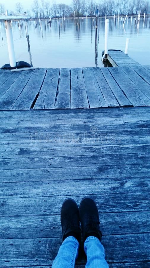 Relaxing on the dock stock photography