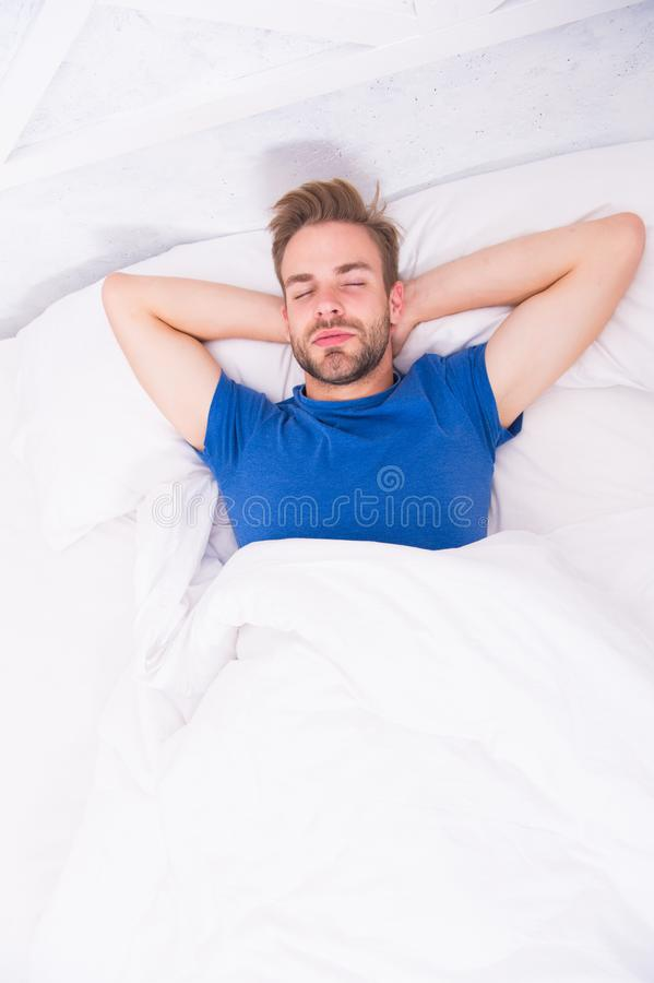 Relaxing before fall asleep. Get enough amount of sleep every night. Bearded man face relaxing. Maintaining consistent. Circadian rhythm essential for general stock image