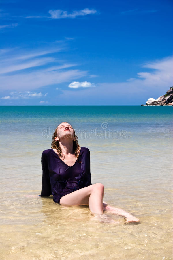 Relaxing girl. In the tropical sea. Thailand stock photo