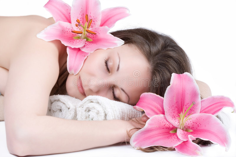 Relaxing girl with flower. Pretty relaxing girl with flower stock image