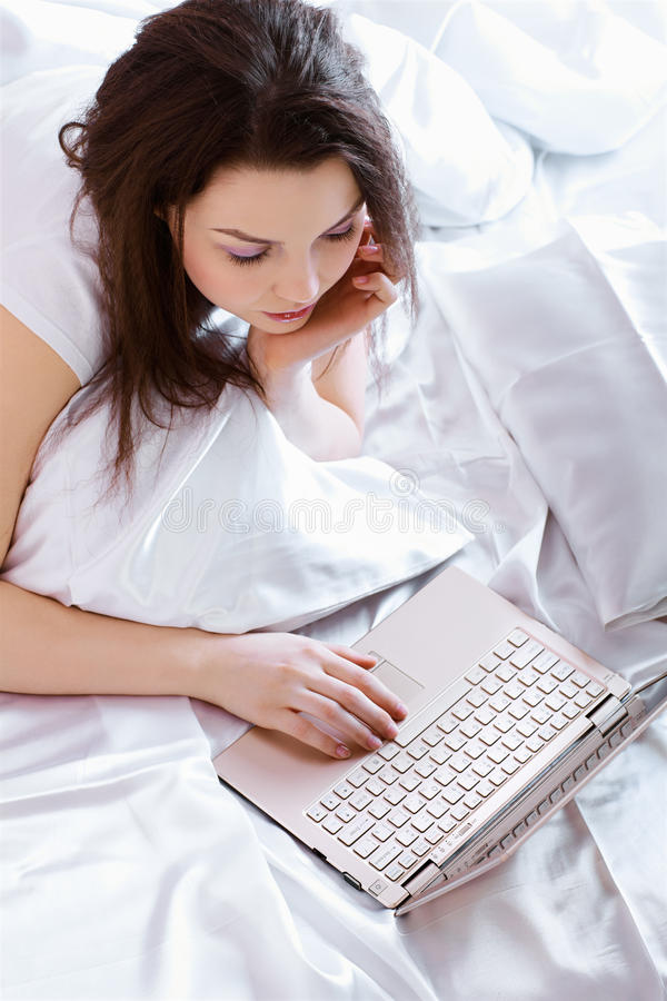 Relaxing girl with laptop