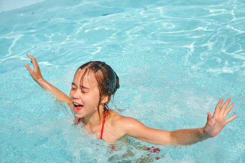 Relaxing girl in water in swimming pool. Outdoors royalty free stock photo