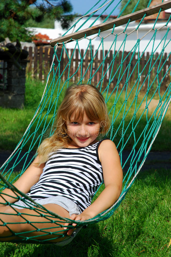 Relaxing In Hammock Royalty Free Stock Image