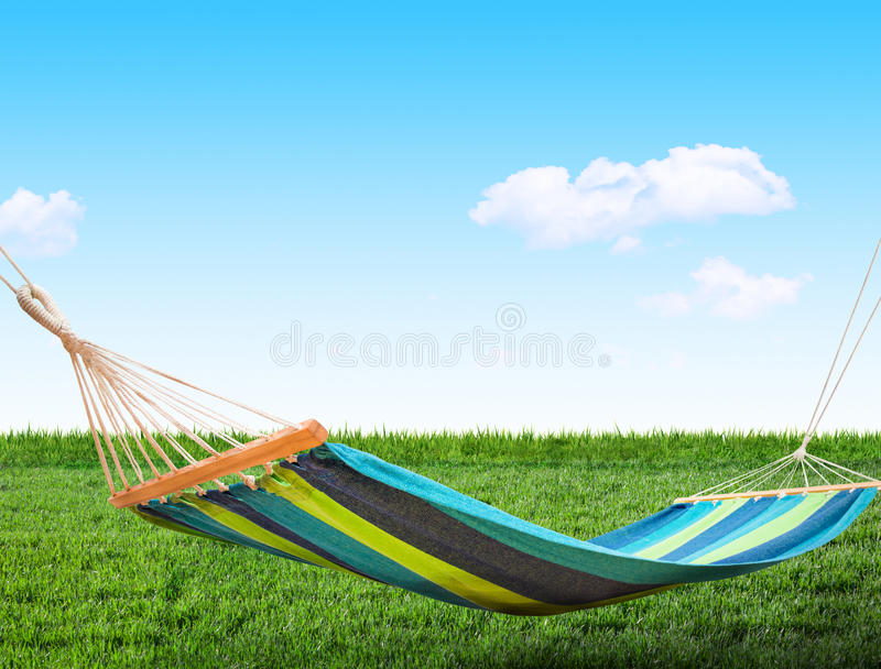 Relaxing on hammock. In backyard stock photos