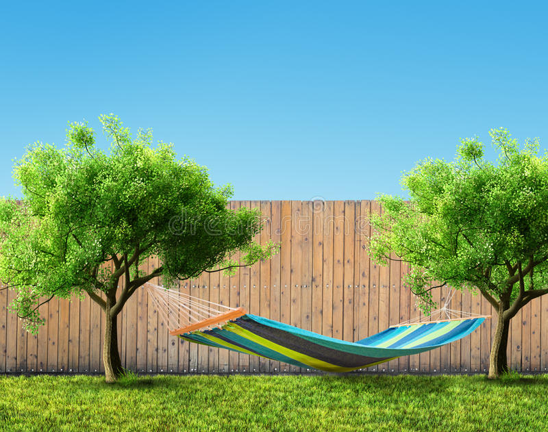 Relaxing on hammock. In backyard stock photography