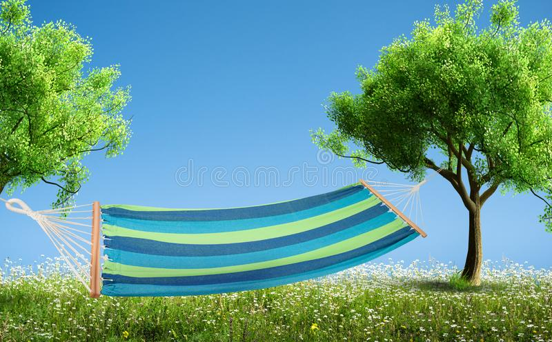 A relaxing on hammock in backyard. Relaxing on hammock in backyard in spring flowers and grass garden royalty free stock image