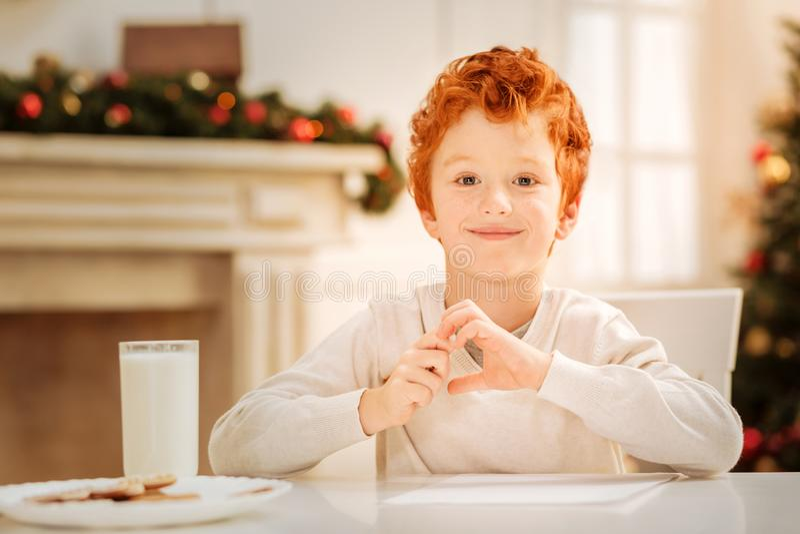 Adorable ginger kid beaming into camera stock image