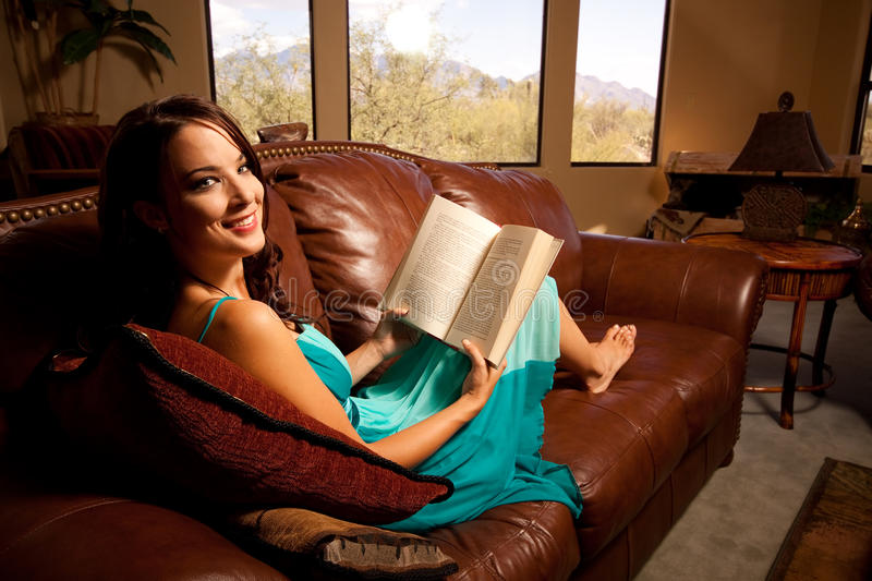Relaxing at home with a book royalty free stock photo