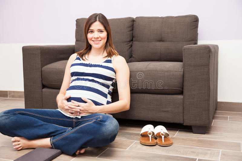 Relaxing at home during pregnancy royalty free stock photo